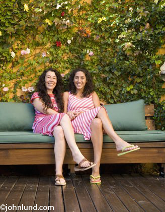 Hispanic mother and adult daughter smiling outdoors Hispanic mother and ...